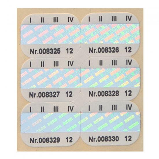 Kombinacija hologramskih in papirnatih nalepk